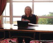 hillary-signing-at-desk-replace-with-i