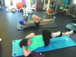 Trainer Renee Goldstein (in blue hat) working on core strengthening exercises with client Karen Brown.