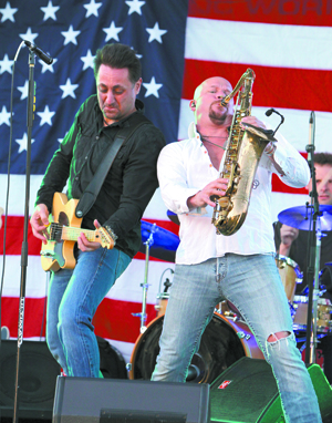 "Mark Salore and Brian ""Bo"" Ognan performing in White Plains at the 4th of July celebration at White Plains High School for a crowd of approximately 15,000 people."