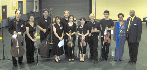 (L-R) The Chappaqua Orchestra members at Shawangunk were: Seth Jacobs (cello), Elizabeth Romano (bassoon), Lou Pappas (doublebass), Cynthia Peterson (executive director), Adam Schommer (horn), Yang Sun Kim (violin), Chie Yoshinaka (violin), Eric Drucker (clarinet), and Jules Lai (viola). Far right: Deputy Supdt. for Programs Neville Andrews and Offender Rehabilitation Coordinator Ebony Blacke. The program at Shawangunk: Octet for Strings, Winds and Brass, by Franz Schubert (two movements); duets for two violins, by Bela Bartok; Danzas Cubanas, by Ignacio Cervantes, arranged for Horn and Bassoon by Paquito D'Rivera; Clarinet Quintet, by W.A. Mozart (one movement); Moon River, After You, and Summertime (by George Gershwin) arranged for two violins and doublebass and Sister Sadie by Horace Silver, performed as a jazz bass solo.