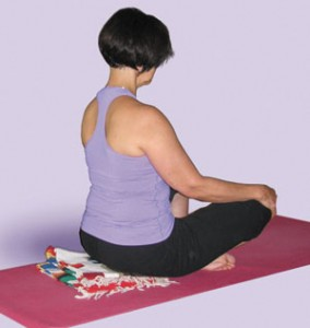 A patient practicing yoga in a free Health & Wellness Program fitness class.