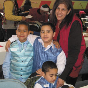 A mom and her three boys enjoying the Westchester Christmas Dinner festivities