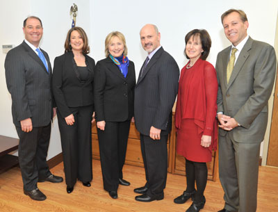 Pre Swearing In:  A photo op for the entire town board: Secretary Clinton with Team New Castle , Councilwoman Elise Mottel and Councilman Jason Chapin. Photo: Carolyn Simpson, doublevisionphotographers.com