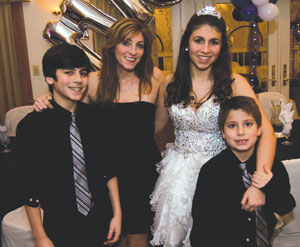 Janine and her kids Steven, Michaela and Alex at Michaela's Sweet Sixteen last year. Note: older son Steven now towers over Janine. Rising Star Photography
