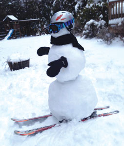 "Following a Houlihan Lawrence office contest inviting staff to submit their favorite snow scene or snowman picture, ""Snowy Peter,"" a skiing snowman built by the Kimtis family won (submitted to IC by mom, Karen)."