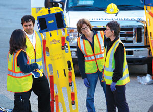 At a drill with the Millwood Fire Department (L-R): Leslie Jameson, Akshay Gupta, Rita Coetzee, Florence Hovy. Bill Bramswig, bramswigphotography.com