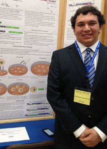 Alex Kaufman with his poster at Intel WESEF