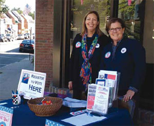 Co-Presidents Jennifer Mebes Flagg and Sheila Bernson register voters in downtown Chappaqua during National Voter Registration Day.