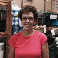 Executive Director Sherry Wolf in the Community Center of Northern Westchester's food pantry.