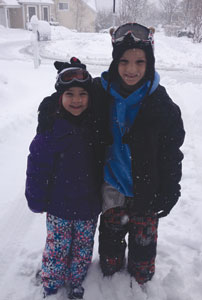 Theresa and Anthony Kosakowski, ages eight and 10 respectively, enjoying outdoor fun during a a snow day in Armonk.