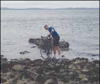 Ken ceremoniously dips his bike in the Pacific Ocean at the start of his coast-to-coast journey.