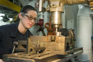 EAST CHINA SEA (Feb. 10, 2015) Machinery Repairman Fireman Cynthia Gramuglia, from New Milford, N.J. mills a channel for a valve coupling in the machine shop aboard the forward-deployed amphibious assault ship USS Bonhomme Richard (LHD 6). Bonhomme Richard is currently deployed in the U.S. 7th Fleet Area of Operations. (U.S Navy photo by Mass Communication Specialist 3rd Class Cameron McCulloch/ Released)