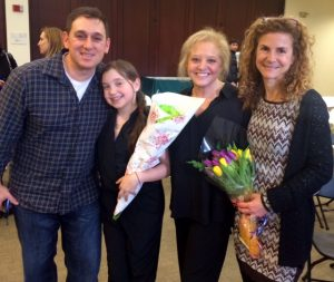 Isabella with her parents, Matt & Amy Yallof, and her JID teacher, Shari Applebaum
