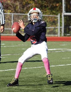 Carter Salore Quarterback #5, who started all 11 games at quarterback, helped lead the Armonk Warriors to the playoffs with an 8-3 record. Photo by Shari Fruhling