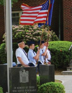 Eagle Scouts flanked by veterans at the American Legion Memorial Day Ceremony