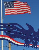 The American Flag and the North Castle Eagle, symbols of the majestic beauty and great strength of our nation.