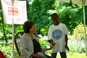 "Lowey with ""Junior Ambassador,"" 8-year-old Christopher."