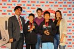 L-R: John Chew, Co-president of the North American SCRABBLE Players  Association; Cooper Komatsu, 7th grader from Los Angeles; Conrad Bassett-Bouchard, 2014 National SCRABBLE Champion;, Sheng Guo; and Danielle Armbrust, Senior Director Global Brand Marketing and Strategy at Hasbro / Photo credit: Patricia A Hocker, NASPA
