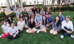 Chloe (seated center in gray top, with sunglasses on her head) with classmates/friends at Columbia University