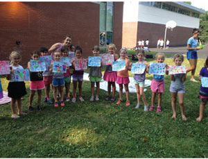 Proud campers showing off their artwork