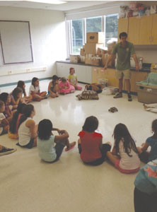 Campers enjoy seeing a turtle during a visit from a nature specialist