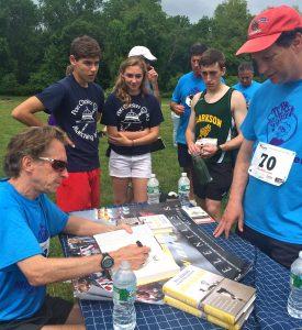 Bill Rodgers signs copies of his book, Marathon Man