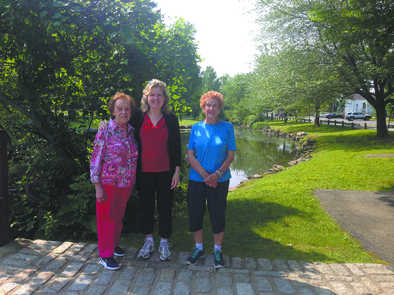North Castle Seniors Nellie Palamarczuk (left) and Faye Barresi (right) walk with Liz Thomas (center), North Castle Senior Recrea- tion Leader, in Wampus Brook Park. Senior walks are regularly scheduled on Mondays and Thursdays at 10 a.m.