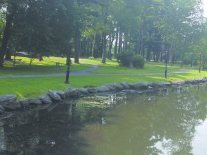 Wide pathways run alongside the water at picturesque Wampus Brook Park.