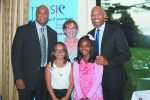 Bernie Williams (left), Conservatory Executive Director Jean Newton (center), and Mariano Rivera with the first recipients of the Clara and Mariano Rivera Music Scholarship, Dyana Taylor Garcia (left) and Mia Sarai Suarez (right).