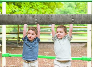 "The author's twin boys ""hanging out"" at the playground."
