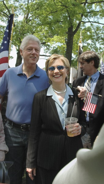 """- """"A Casual Moment/Memorial Day 2006"""" by Marianne Campolongo Photography. The Clintons relax after the 2006 Memorial Day parade in Chappaqua, NY. This photograph will be displayed in the exhibition's """"Celebrity Neighbors"""" section."""