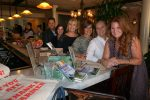 Back to front: Barry Graziano, Chappaqua & Armonk Manager, Houlihan Lawrence; Roselyn Harburger, Katonah Manager, Houlihan Lawrence; Leslie Lampert, Owner, Cafe of Love; Amanda Gomolka, Manager, Cafe of Love; Jackie Graziano; Westchester Ambassador, FarmOn! Foundation; and Tessa Edick, Executive Director, Founder, FarmOn! Foundation