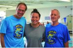 Boys and Girls Club Marlins' coaches Bobby Hackett (Distance Coach), left, and Dennis Munson (Head Coach/Aquatic Director), right, welcome Olympian Ariana Kukors.