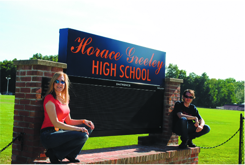 Back at their mutual alma mater, Tracy and Luke show their HGHS spirit.