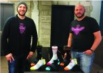 David (left) and Andrew Heath with their colorful Bombas socks.