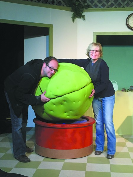 Adam David Cohen (Artistic Director) and Ann Shankman (Artistic Direc- tor of the Community Stage) with Audrey II of October/November 2015's Little Shop of Horrors.