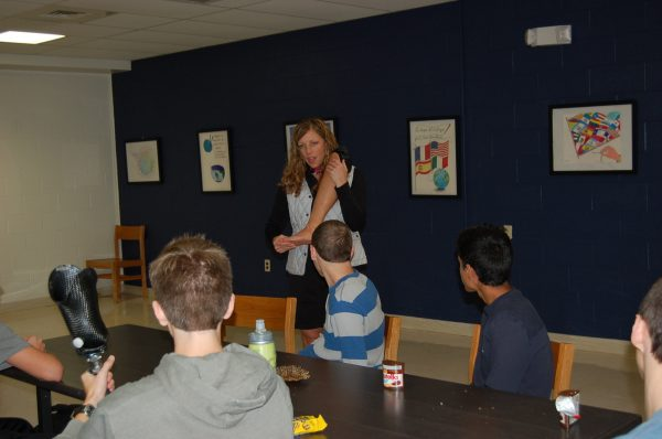 Retired U.S. Army Lt. Col. Patty Solimene Collins shows Byram Hills students an artificial leg.