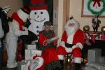 Santa and Mrs. Claus Visit Sunshine Children's Home