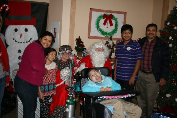Jay Lokhande, who lives at the Sunshine Children's Home, along with his family celebrating Christmas with Santa and Mrs. Claus.