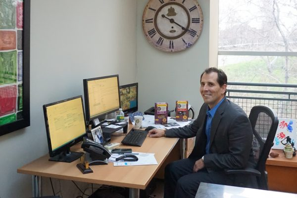 At his desk with Greyston Bakery products: Mike Brady, CEO and president, Greyston Foundation