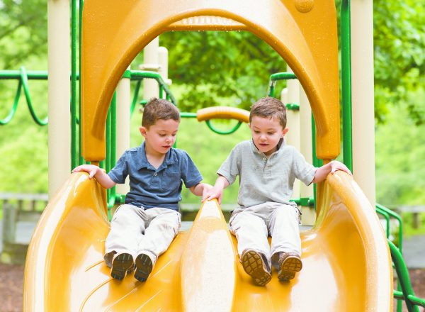The author's twin boys' tandem sliding at the smaller playground at Gedney Park.
