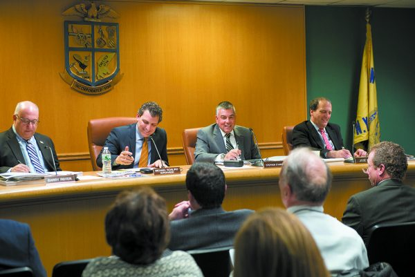 Supervisor Schiliro (second from left) leads a North Castle Town Board meeting.