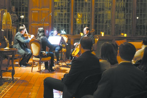 Chappaqua Orchestra members performing during a Winter fundraiser