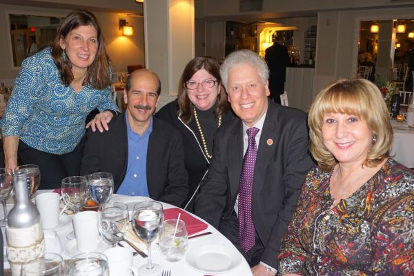 Ann Herrero (middle), Paul Harris Award recipient, with County Legislator Mike Kaplowitz (right) and his wife Jane, and friends.