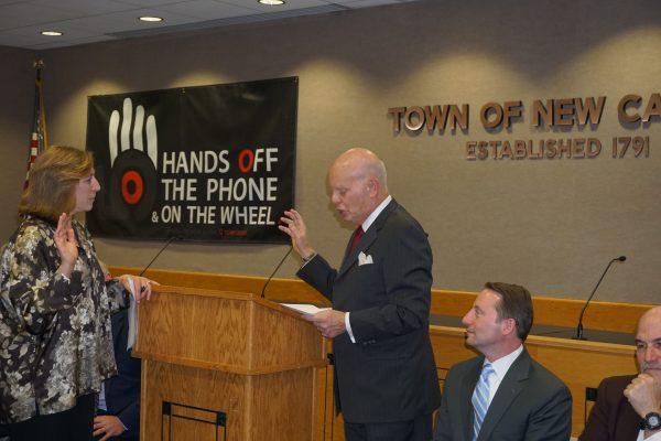 Former state Senator Steven Saland swearing in Hala Makowska as a town board member