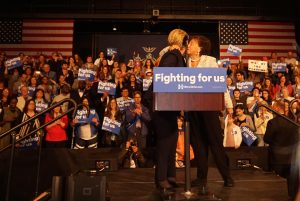Congresswoman Nita Lowey embraces Hillary Clinton after rallying for her right before her speech to supporters.