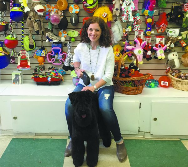 Inside Wags and Whiskers on King Street: Chappaqua's Tracey Appel with Charlie, a Kerry Blue Terrier