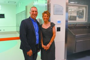 Geraldine C. and Joseph M. La Motta outside an operating room named for them