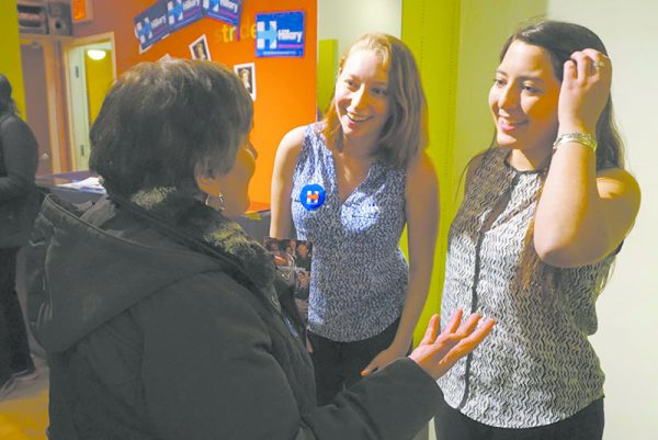 Westchester field organizers Hannah Fine and Izzy Bugatti greet a volunteer at the White Plains HRC campaign headquarters grand opening.