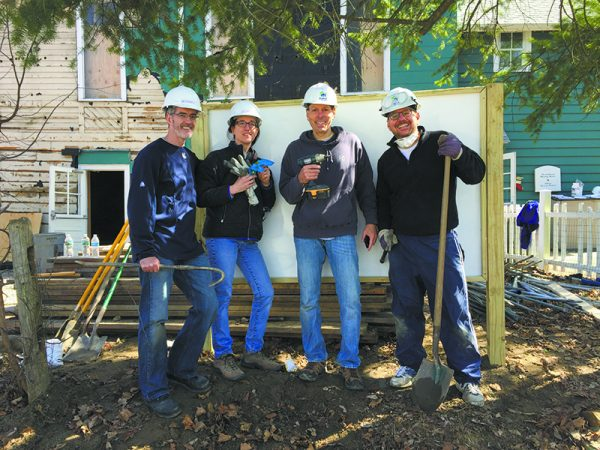Smiles all around after heavy-duty digging and sign-building. (L-R): Chappaqua resi- dents Michael and Eileen Gallagher, Greg Simon, and Warren Gottlieb.